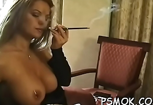 Sexy babe touches themselves whilst relishing a cigarette