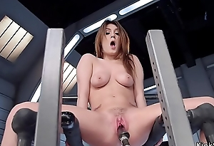 Busty brunette fucks black sex toy machine