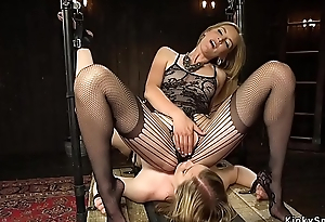 Blonde lesbian in suspension spanked