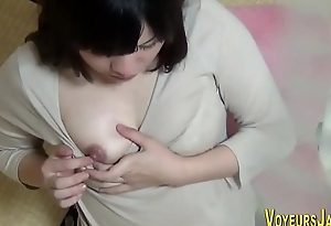 Asian whore rubs her vag